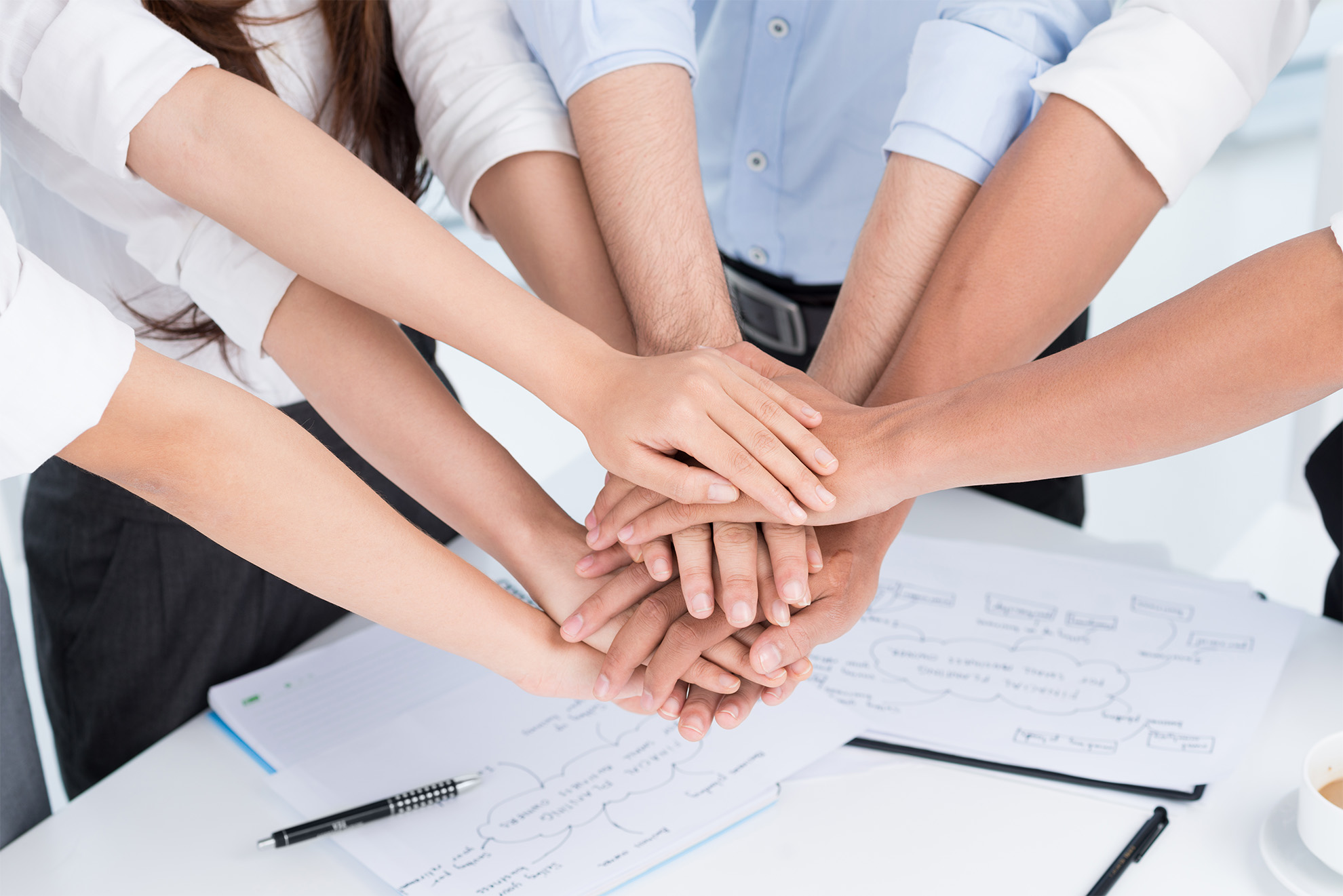 Closeup of people's hands working together